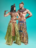The man, woman in the images of Egyptian Pharaoh and Cleopatra stock photo