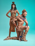 The man, woman in the images of Egyptian Pharaoh and Cleopatra royalty free stock image