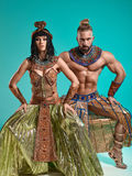 The man, woman in the images of Egyptian Pharaoh and Cleopatra stock image