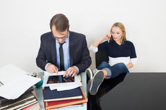 Man and woman are incompatible. business office Royalty Free Stock Images