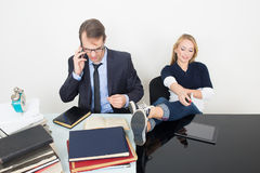 Man and woman are incompatible. business office Stock Images