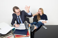 Man and woman are incompatible. business office Stock Image