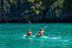 Man and woman in an inflatable rubber boat Royalty Free Stock Images