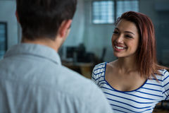 Man and woman interacting each other. In creative office Stock Photos