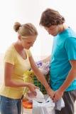 Man and woman ironing stock photo