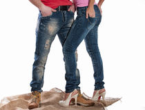 Man and woman in jeans Stock Images