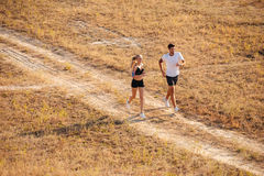 Man and woman joggers exercising outdoors. Man and women joggers exercising together outdoors royalty free stock images