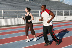 Man and Woman Jogging royalty free stock photography