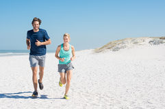 Man and woman jogging Royalty Free Stock Image