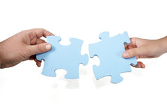 Man-woman joining puzzle concept Royalty Free Stock Images