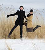 Man and woman jump on lake beach Stock Photo