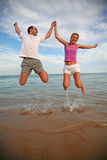 Man and woman jumping Royalty Free Stock Image
