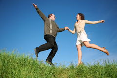 Man and woman jumping Royalty Free Stock Images