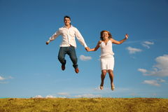 Man and woman jumping Stock Photo