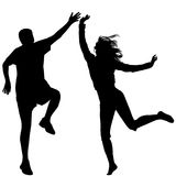 Man and woman jumping. Man and woman silhouettes jumping Royalty Free Stock Photos