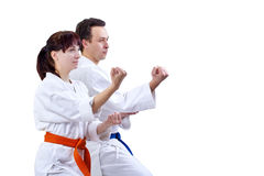 Man and woman in karategi stand in the rack karate royalty free stock image