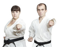 Man and woman in karategi are training blow hand Royalty Free Stock Image
