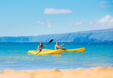 Man and Woman Kayaking in the Ocean stock photography