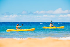 Man and Woman Kayaking in the Ocean stock image