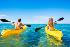 Man and Woman Kayaking in the Ocean Stock Photos