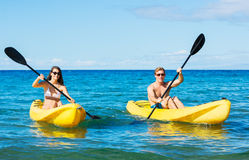 Man and Woman Kayaking in the Ocean Royalty Free Stock Photo