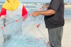 The man and the woman are keeping the fishing net. stock image