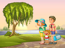 Man, woman and kid standing around tree Royalty Free Stock Images