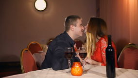 Man and woman kiss romantic evening in love candle restaurant Valentine's Day drinking wine. Man and  woman kiss romantic evening in love candle restaurant stock footage