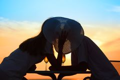 Man and woman kiss on sunset outside. Man and woman kiss behind hat on sunset outside royalty free stock photo