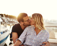 Man And Woman Kissing on a Boat. Sun Setting Stock Photo