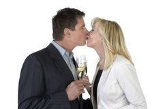 Man and woman kissing and celebrating with Champagne Stock Photography