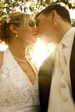 Man and Woman Kissing during Daytime Stock Image