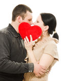 Man and woman kissing with a heart. Stock Images