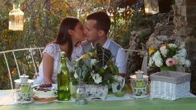 Man and woman kissing at the holiday table Royalty Free Stock Photo