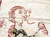 Man and woman kissing. Medieval fresco in a Swedish church royalty free stock photography