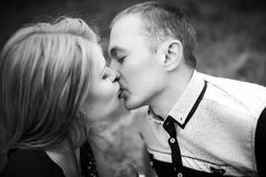 Man and woman kissing outdors. Young teenagers on romantic date. beautiful girlfriend kissing and have a good time with boyfriend. happy family relationship Stock Photography