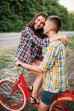 Man and woman kissing on retro bike Stock Images