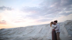 Man and woman are kissing on sand quarry stock video footage