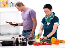 Man and woman in the kitchen Royalty Free Stock Images