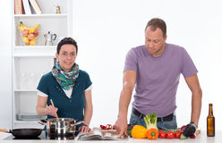 Man and woman in the kitchen Royalty Free Stock Photo
