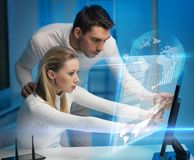 Man and woman in laboratory Stock Photos