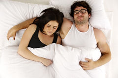 Man and woman laid in white bed asleep cuddling Stock Photos