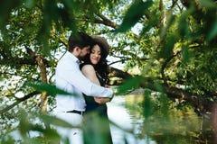 Man and woman at the lake Royalty Free Stock Photos