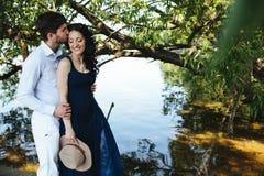 Man and woman at the lake Stock Photos