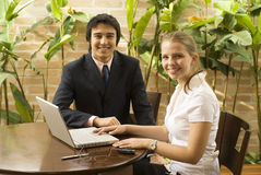 Man and Woman with Laptop Stock Image