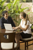 Man and Woman with Laptop Stock Photos