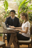 Man and Woman with Laptop Royalty Free Stock Photography