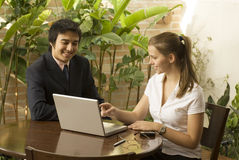 Man and Woman with Laptop Stock Photo