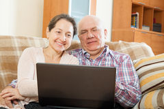Man and woman   with  laptop Royalty Free Stock Photo