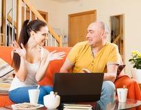 Man and woman at  laptop Stock Photos